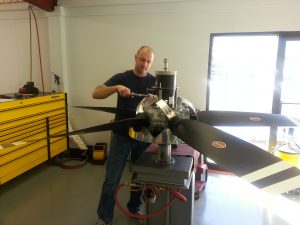 Technician working on Hartzell propeller in prop shop at Intercontinental Jet Service Corps