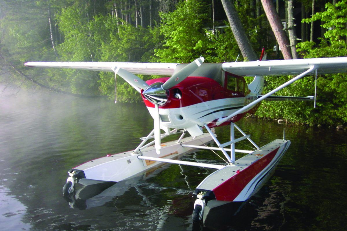 Red float plane with 3-blade Hartzell propeller