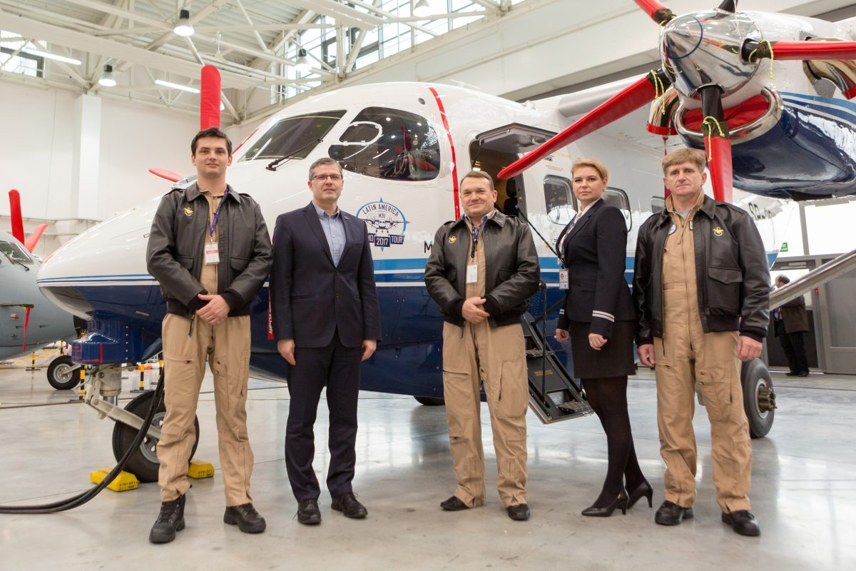 Pilots in front of an aircraft for Latin America demo tour