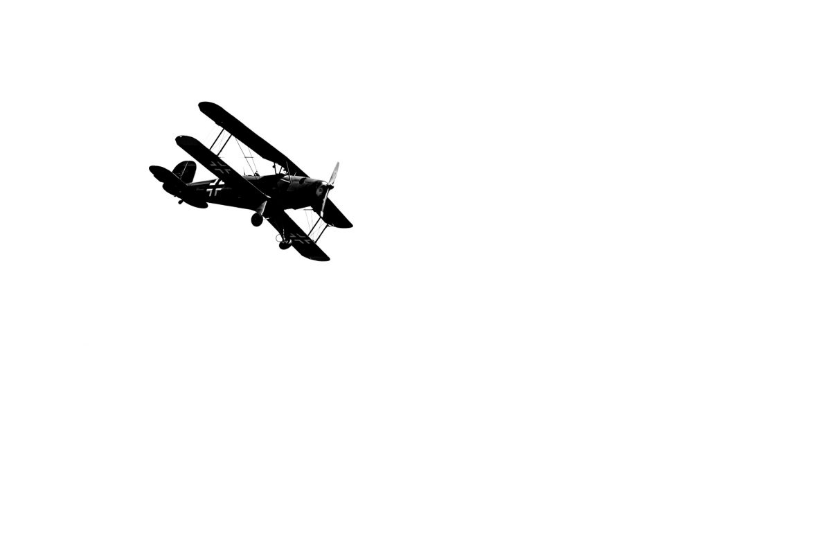 Low angle view of german biplane flying against sky