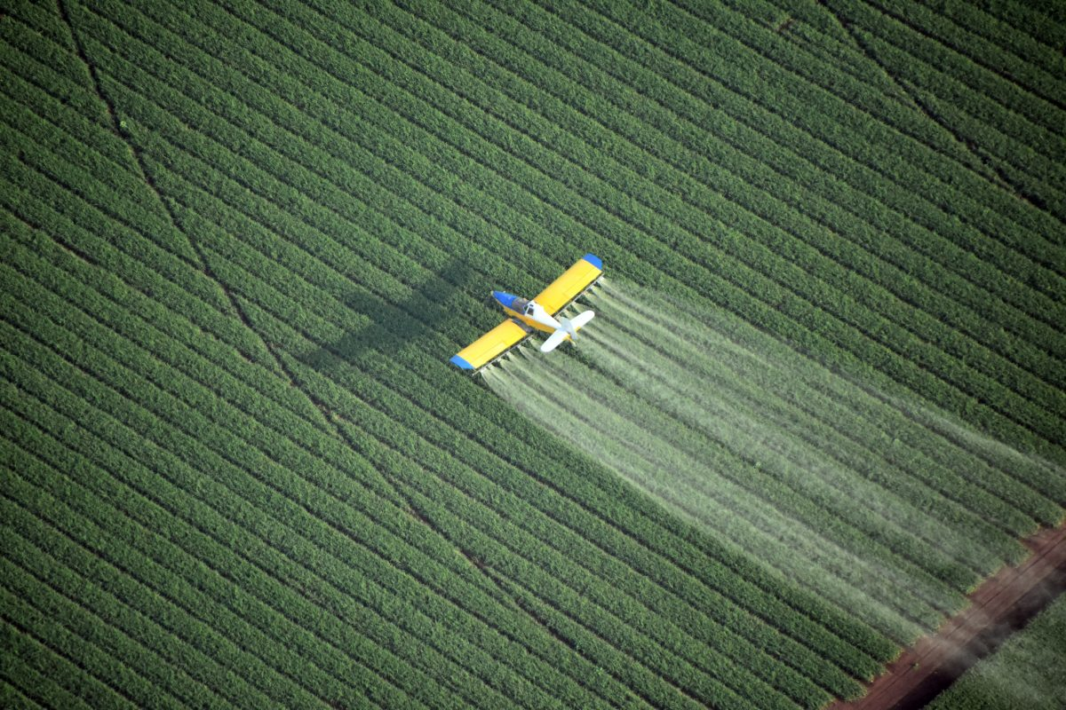 Looking down on a crop duster, agricultural plane