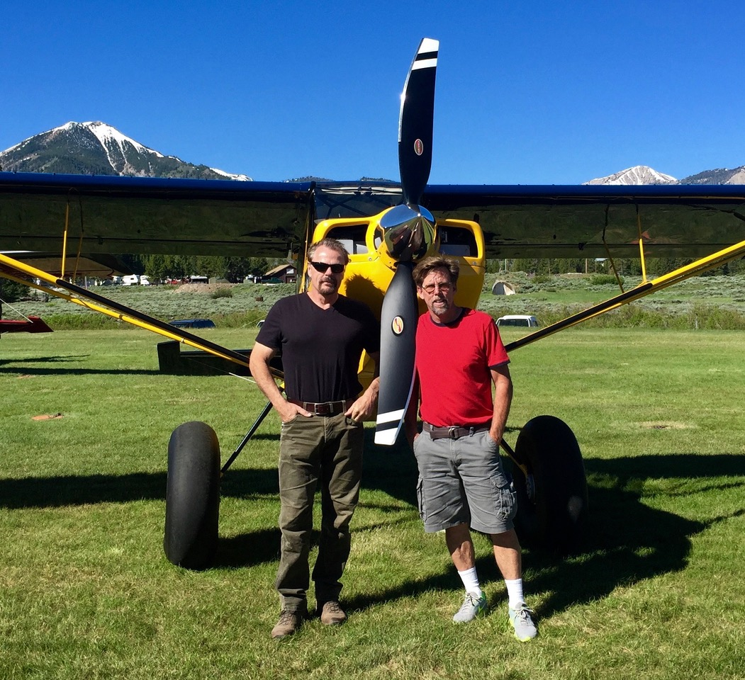 Kacey Lindsay and Bob Hannah pictured in front of yellow Scout airplane with Hartzell Trailblazer Propeller