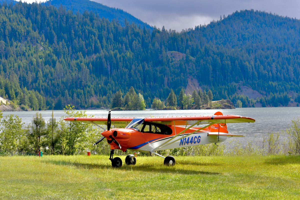 CubCrafters Orange NX Airplane in mountains