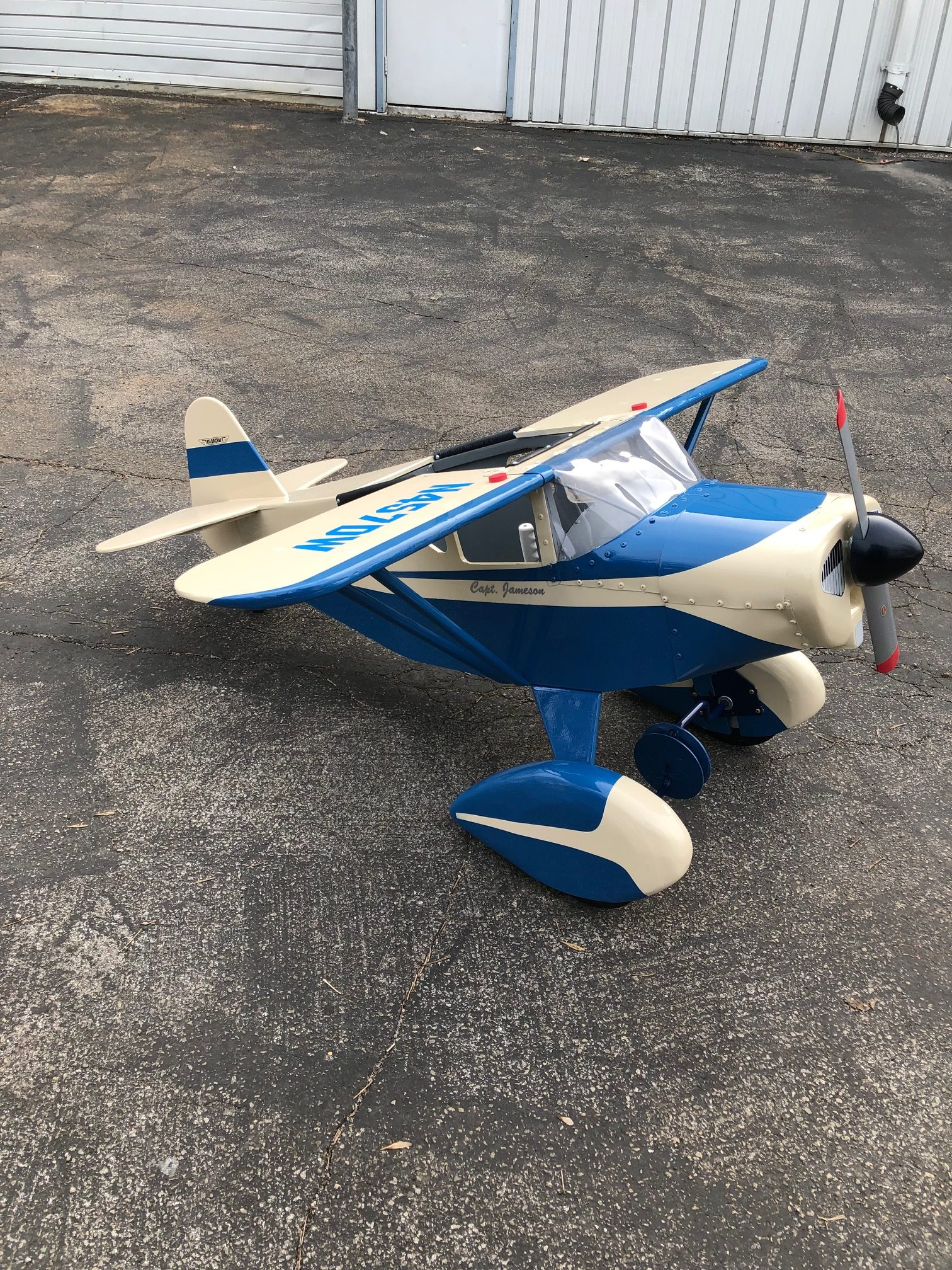 Blue and white Taylorcraft Pedal Plane on the ground