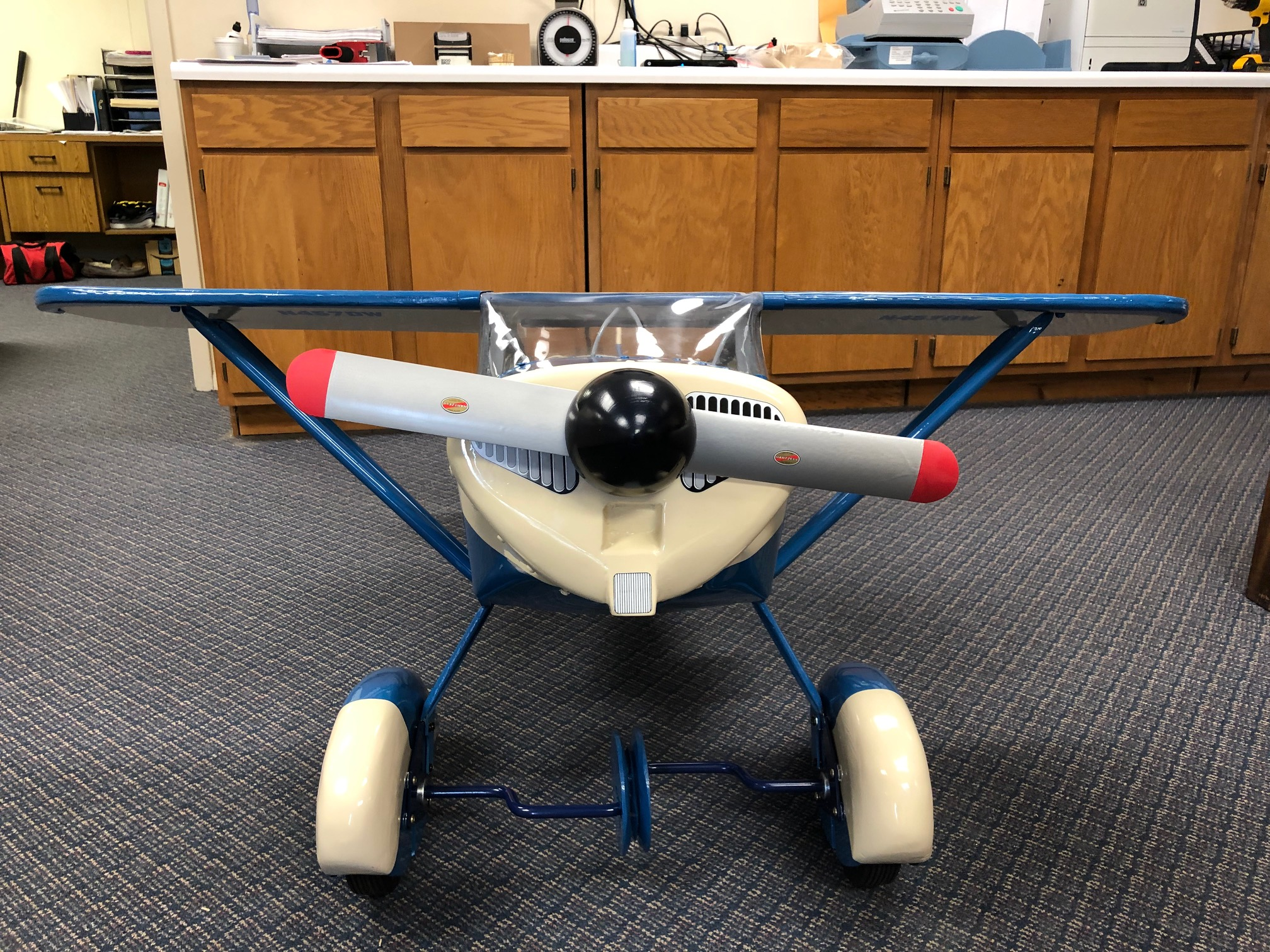 Forward facing view of Pedal plane toy on the ground
